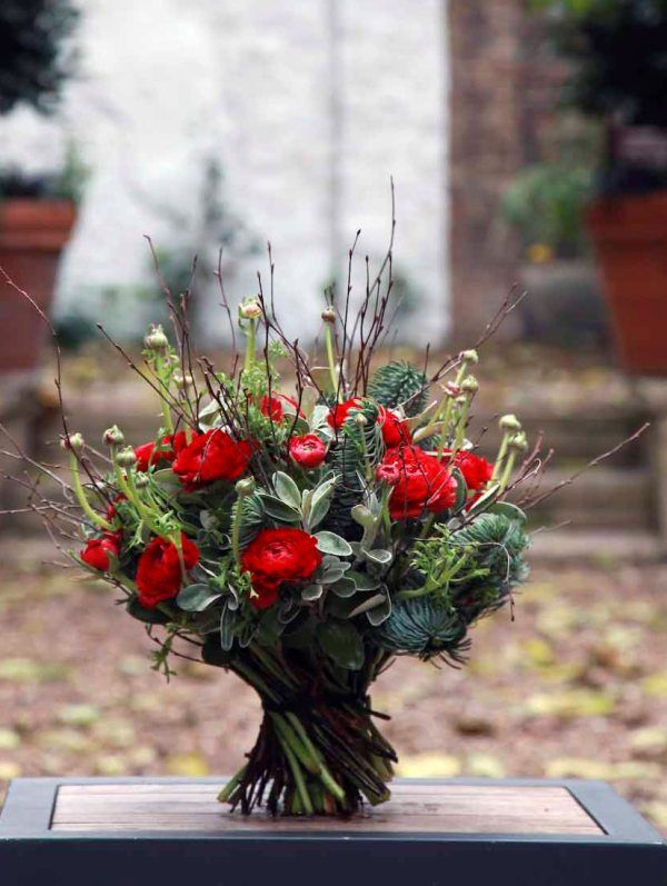 Red Ranuncula and Seaonal Foilage Christmas Bouquets