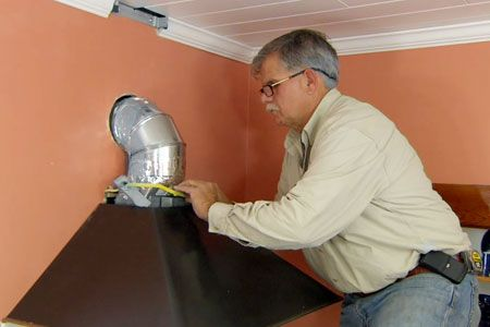 This Old House general contractor Tom Silva installs a new range vent hood