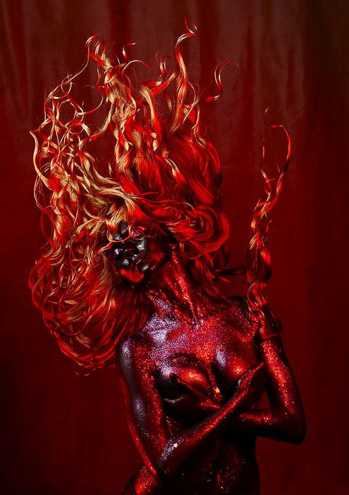 ...my flesh bubbles and my eyes turn amber. my hair flames and a single touch could kill...