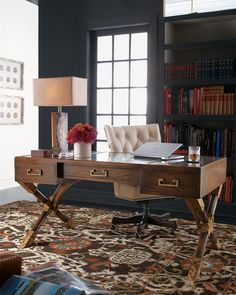 """From the John-Richard Collection. Made of acacia wood with a dark finish. Topped with antiqued eglomise glass. X-design legs. Three drawers on front. 62""""W x 34""""D x 30""""T. Imported."""