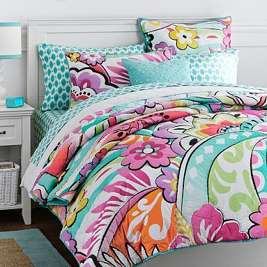 It feels beachy or young girl to me but Kait might like it!...Hibiscus Quilt + Sham #pbteen