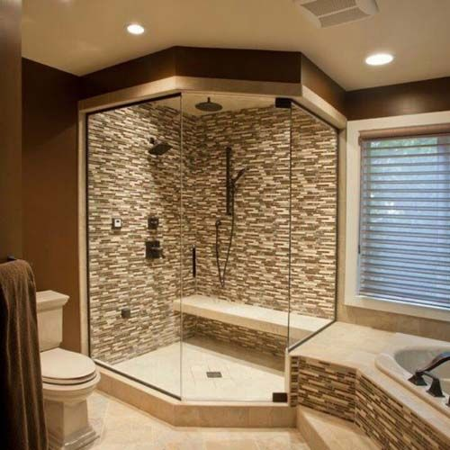 Marble glass shower, with pony wall and adjacent vanity. Description from…