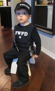 "Super cute DIY Police Costume with padded ""bulletproof"" vest."