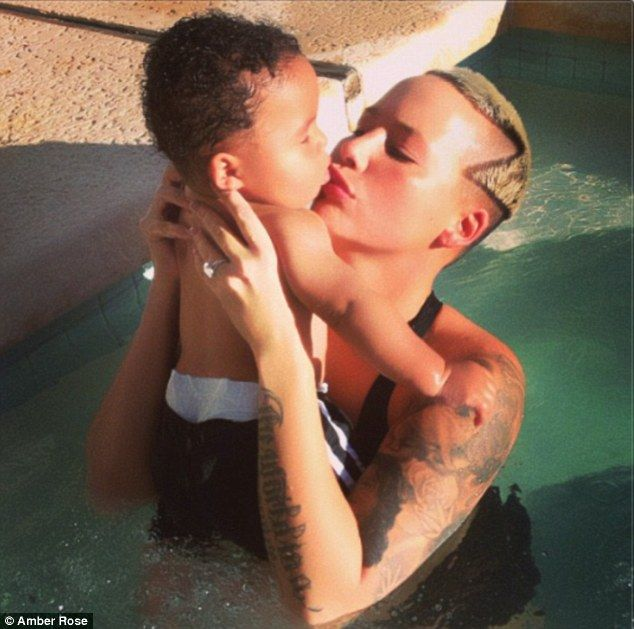 Wild mama: Amber Rose shows off her new buzz cut as she poses with her son Sebastian