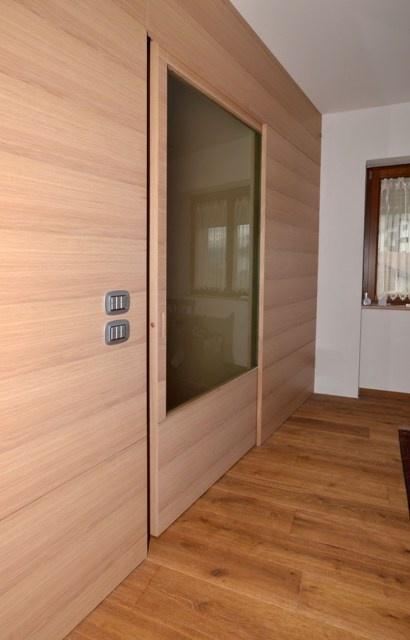 Kitchen-living room divider, living room made of durmast flamed with sliding doors.