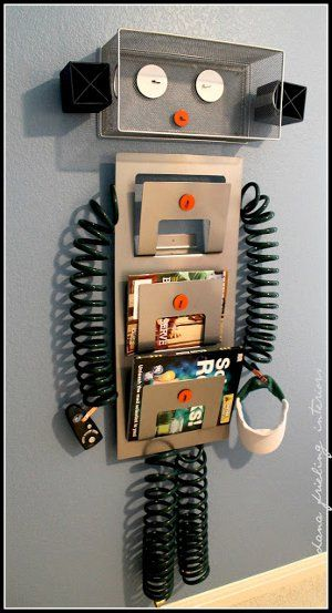 Too cute! Robot magazine holder for a boys room a even an office