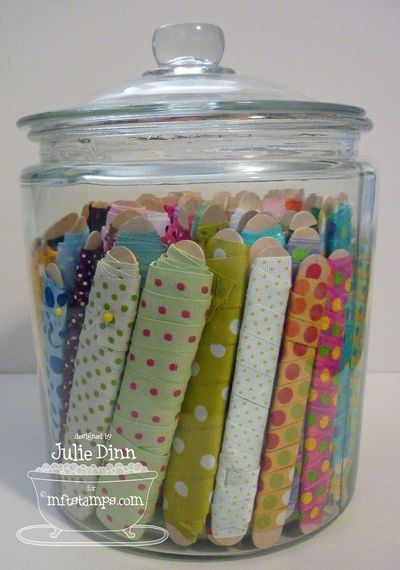 Great ideas for ribbon storage using glass jars and wide Popsicle sticks!: