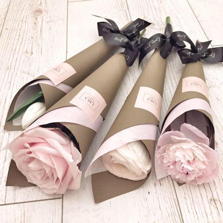 Rose, peony, tulip, and ranunculus in brown paper.