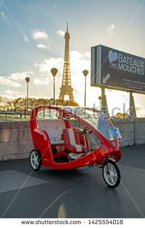Stock Photo: Paris, France – November 13, 2018: Bright red bicycle taxi with Fer…