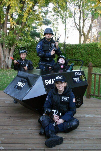 SWAT Team Family Halloween. Great idea for child in wheelchair.  See it. Believe it. Watch thousands of SCI videos at SPINALpedia.com