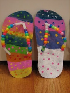 Flip-flops made with cereal boxes, pipe cleaners, beads, and paint