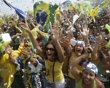 FILE - In this Oct. 2, 2009 file photo, people celebrate after Rio de Janeiro won the nomination to host the 2016 Olympic Games at the Copacabana beach in Rio de Janeiro, Brazil. The Olympic flame goe