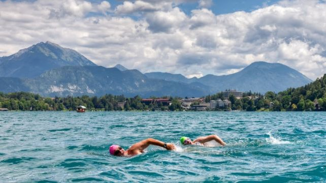 Swim Europe's breathtaking lakes | Swimming trips, Lake swimming Austria, Italy, Slovenia | Combadi #lakes #nature #swimming