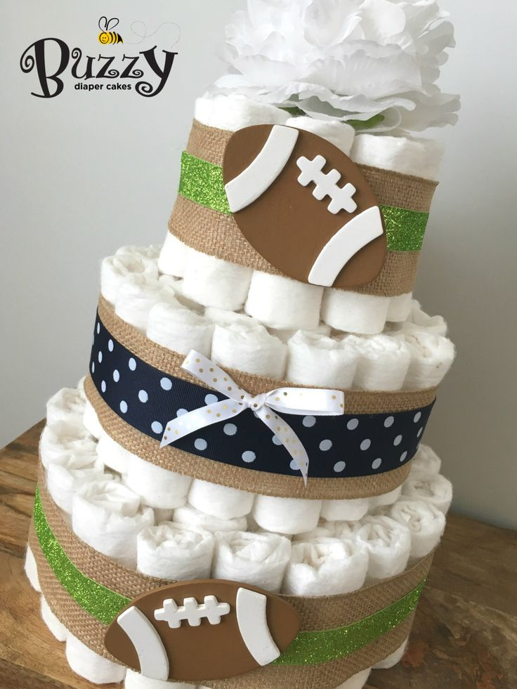 Seahawks Football Diaper Cake, Lime and Navy Baby Boy Diaper Cake, 3 Tier Little Man Shower Centerpiece by BuzzyDiaperCakes on Etsy https://www.etsy.com/listing/469244494/seahawks-football-diaper-cake-lime-and