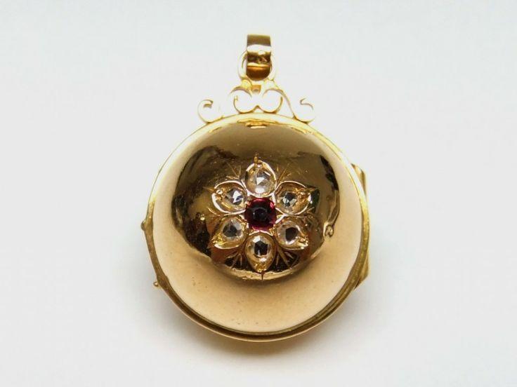 18ct ball diamond and ruby locket