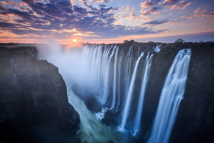 2- Victoria Falls in Zimbabwe  Located on the Zambia and Zimbabwe border, you will be able to spot those waterfalls from many kilometers away. Near the Waterfall, there is also a jungle which you can visit.