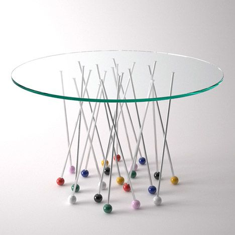 http://www.dezeen.com/2015/05/28/daniele-ragazzo-liaison-table-supported-giant-pin-shaped-legs/
