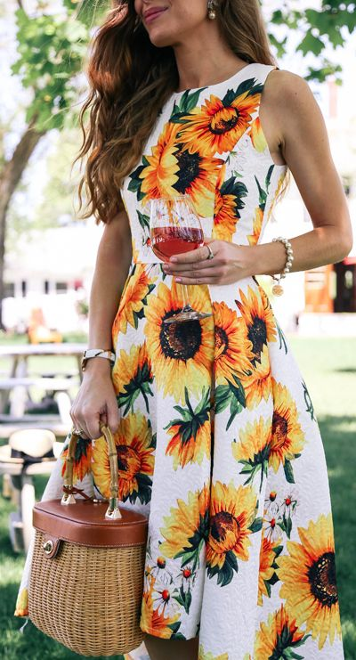 Flower power is the next wave so get on it and snag this spring-ready waterfall dress with sunflowers sweetly dispersed throughout. Sprightly Sunflower Jacquard Waterfall Dress featured by Enchanting Elegance Blog