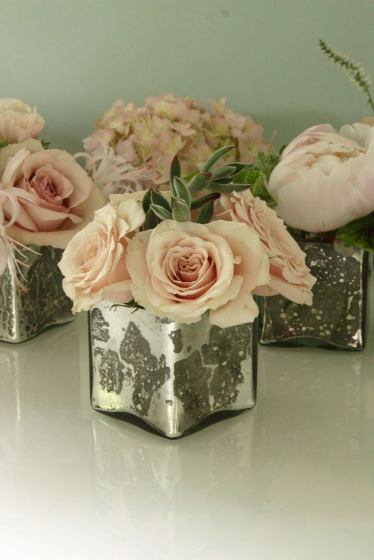 Celebrity centre pieces mercury vases roses
