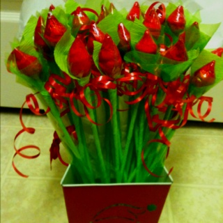 Hersey Kisses Rosebuds!! Very easy, just a little time consuming. I used tape, green and red streamers plastic baggies, green cellophane, ribbon and bamboo skewers.