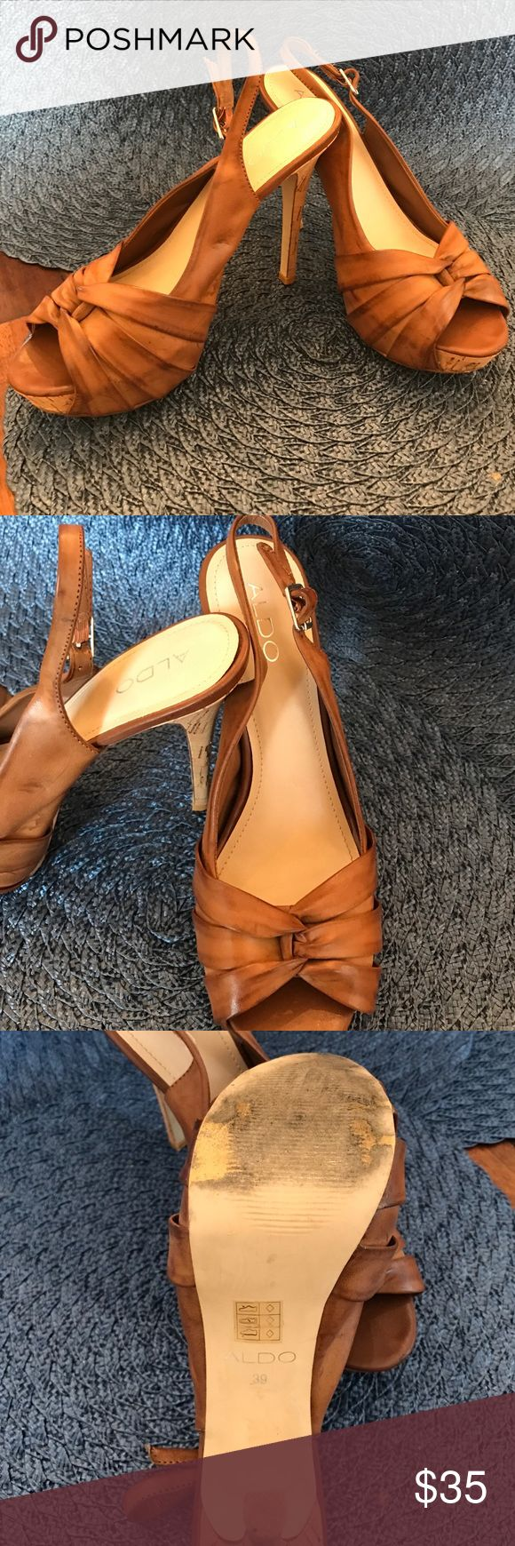 Cognac cork 5 inch heels by Aldo size 39/8 These shoes have only been worn 2 to 3 times and they look so great with spring/summer dressses or with jeans!! These are Aldo size 39 which is a women's 9 size. I typically wear a 7.5 or 8 so they could work for up to an 8.5, but a true 9 would be too small. Aldo Shoes Heels