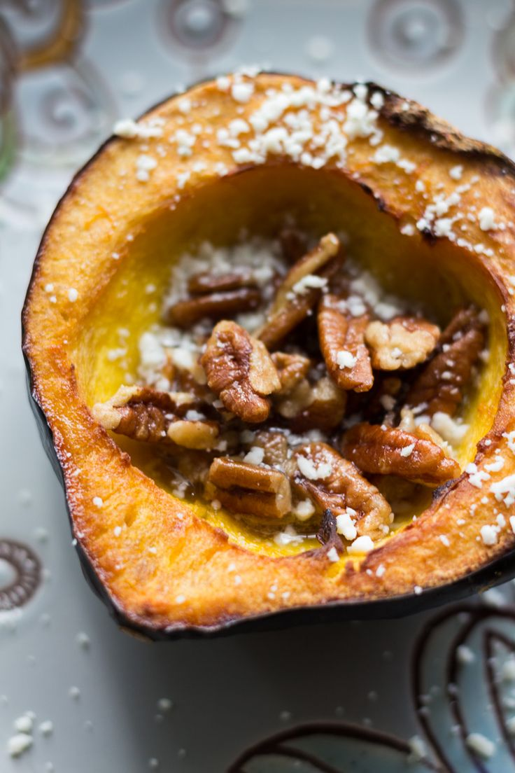 Rich, sweet roasted acorn squash doused in maple butter and filled with maple butter roasted pecans, then topped with blue cheese crumbles. TisTheSeasons AD