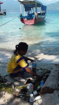 Kids helping to clean the beach of Gili Air