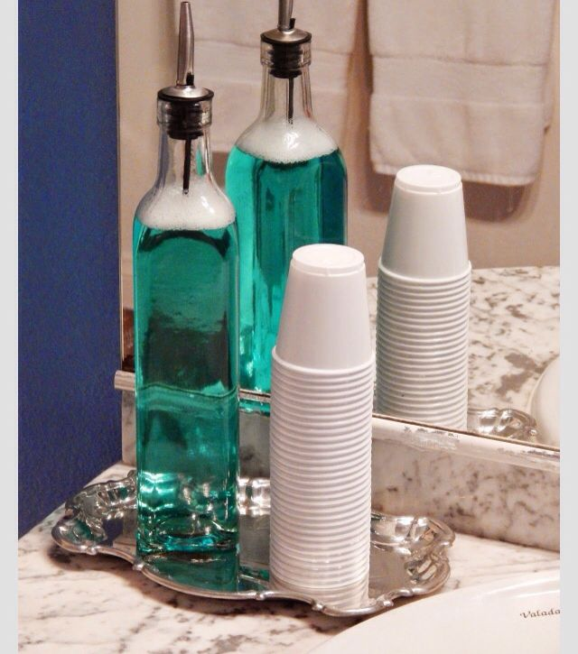 Use an oil/vinegar dispenser for mouthwash! Very classy and inexpensive.