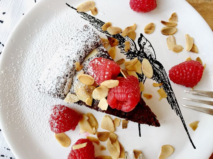 Flourless Chocolate Cake with Raspberries and Toasted Almonds by @bi
