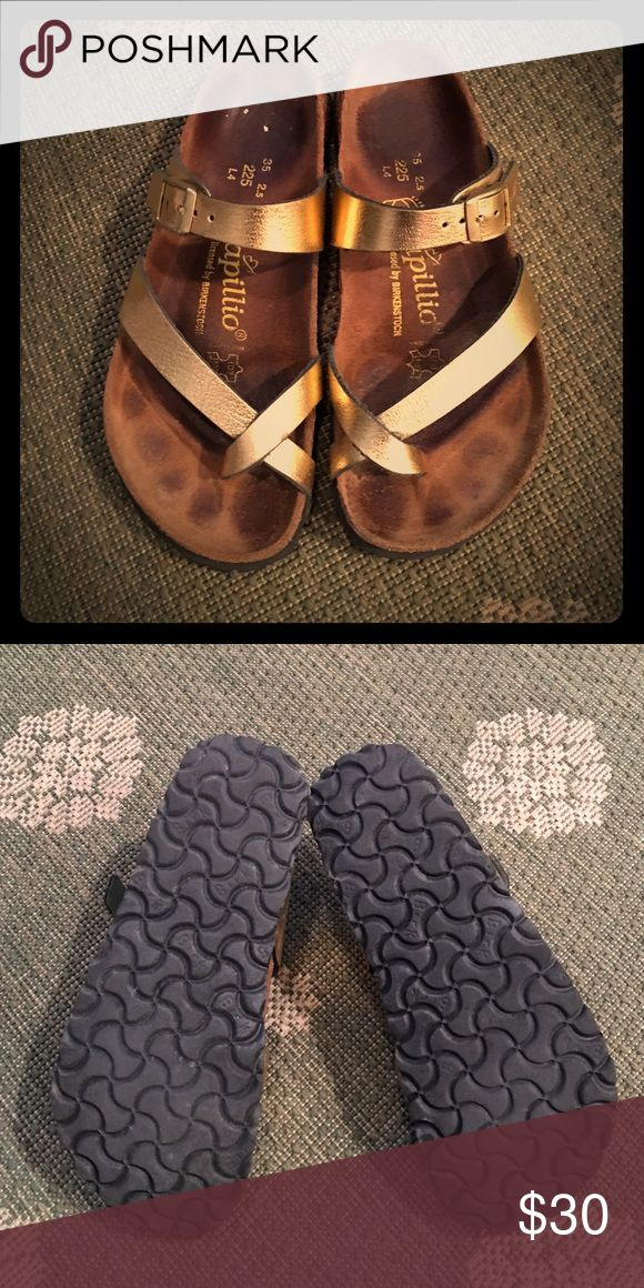 Birkenstock Papillio Gold Sandals in size 35 Metallic Gold Papillio Birkenstock sandals in size 35.  Great feminine style that wraps around the front of the foot with crossover metallic straps.  Gently worn with sole in great condition. Birkenstock Shoes Sandals