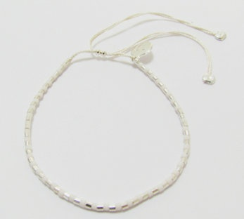 Sterling silver and glass bead bracelet:  White glass bead and sterling silver bracelet on 100% silk thread.  Size adjustable.  $50