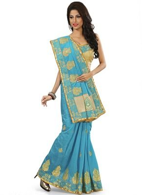 Vasu Saree Turquoise Silk Party Wear Saree With Designer Blouse - Buy Online in India for prices starting at Rs. 4102 on Shimply.com. ✔ Fast Shipping ✔ 7 Days Return ✔ Genuine Products