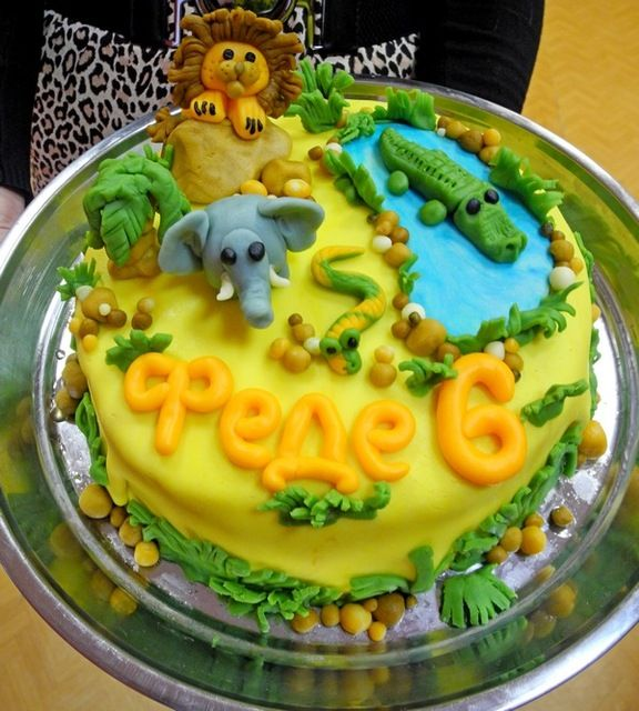 Cake at a Jungle Party cute idea... But I'm sorry to say mine with be in better shape.