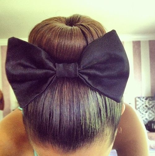 Ballerina Bun with a bow, too cute! Would look great for Kate's dance recital!