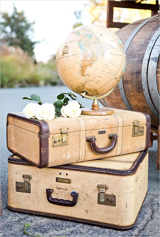 suitcases and globe decor | travel inspired wedding | colorful wedding ideas | #weddingchicks
