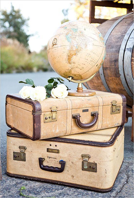 suitcases and globe decor | travel inspired wedding | colorful wedding ideas | #weddingchicks