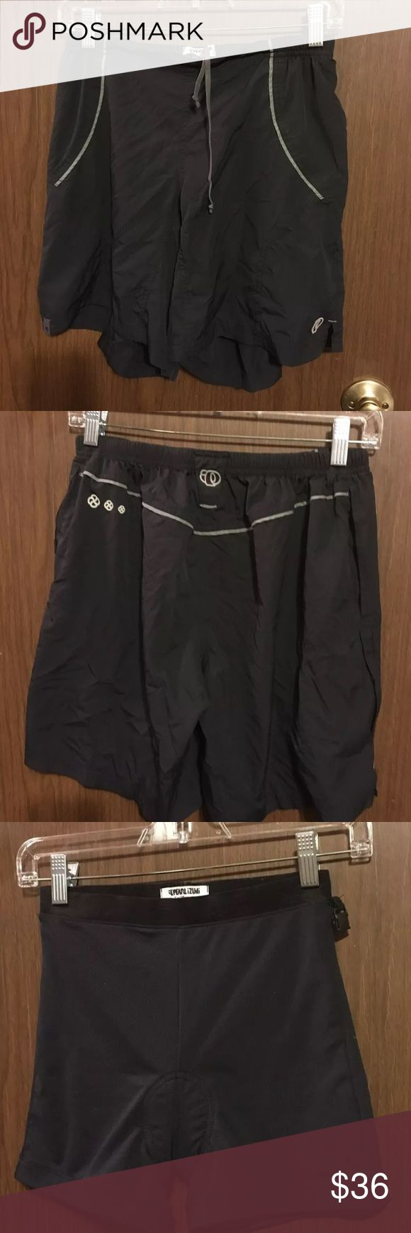 Pearl Izumi hiking cycling shorts Small Quick dry mountain biking shorts with separate interior padded compression shorts.  They attach with a clip on each side.  Size is ladies small  Compression shorts were never worn.  Nylon shorts were worn very little. I graduated to a medium pretty fast.   Authentic Pearl Izumi.  Great set. Pearl Izumi Shorts Cargos