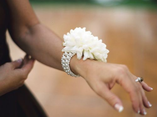 Pearl Bracelet Corsage.  PInned by Aflorall.com from http://mercinewyork.com/blog/2012/10/23/creative-corsage-idea-for-moms-and-grandmas-from-jl-designs/ ~Afloral.com has high-quality faux flowers and supplies for your DIY wedding ideas.