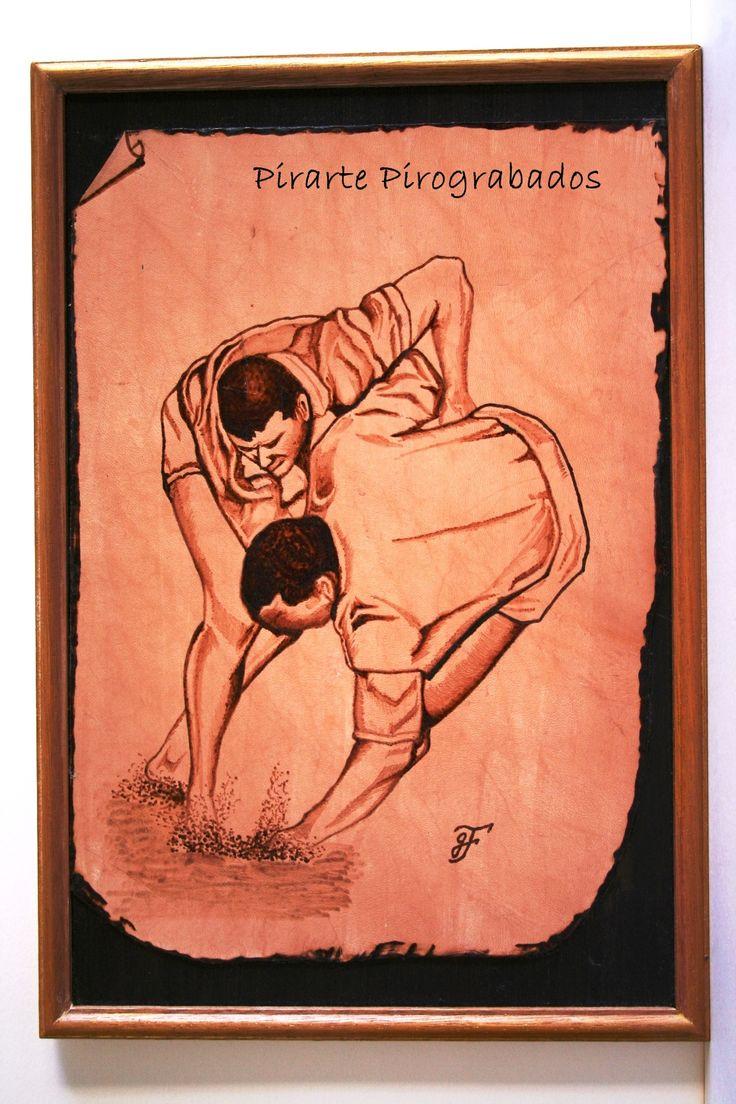 Lucha canaria, pirograbado sobre piel y montado sobre madera
