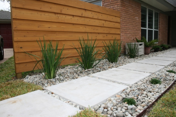 Front sidewalk- concrete pavers + grass plants + stone
