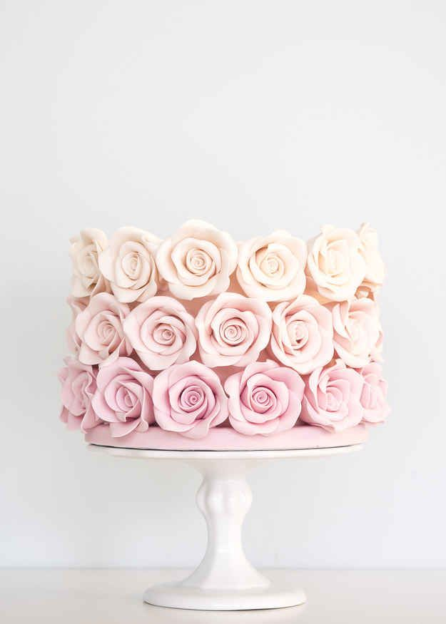 Wedding cake with ombré pink roses. Gorgeous!