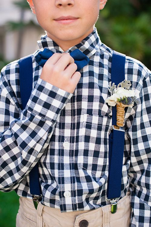 How cute is this ring bearer in his gingham shirt?! | @shewanders | Brides.com