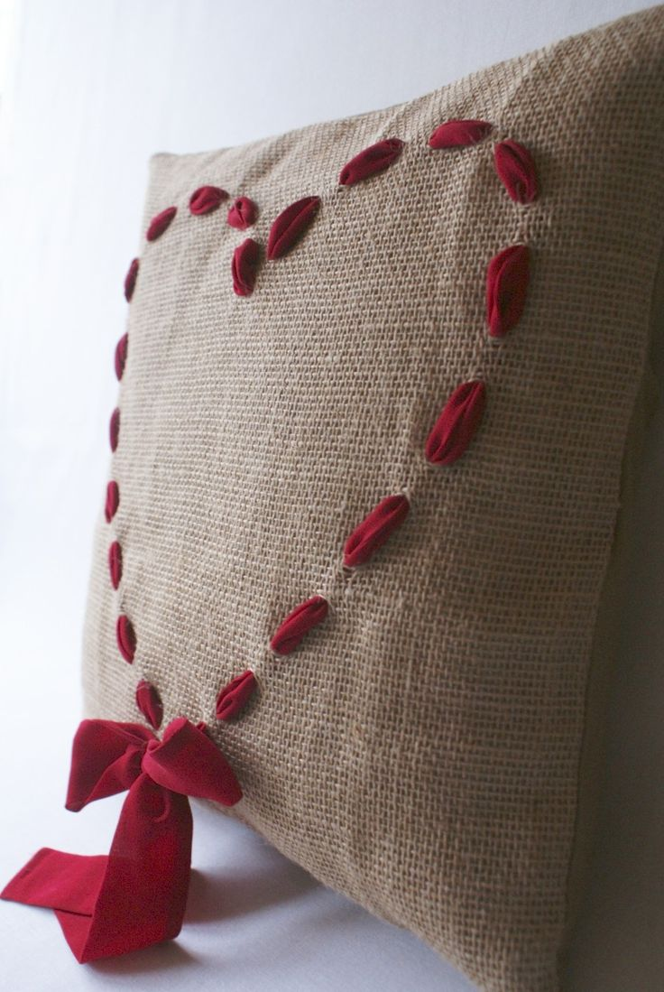 Cushion love ....need to figure out how to get thick ribbon into burlap- sew with a needle with a very big eye. Try an upholsterer's shop.