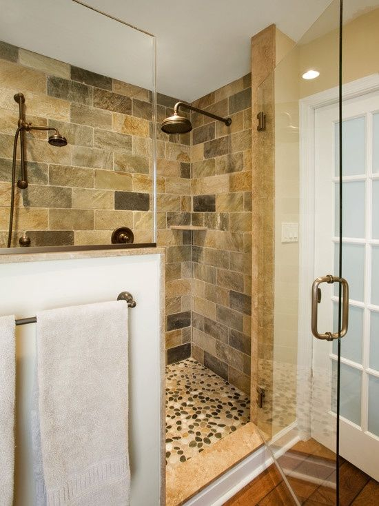 Pebble shower floor with stone tile