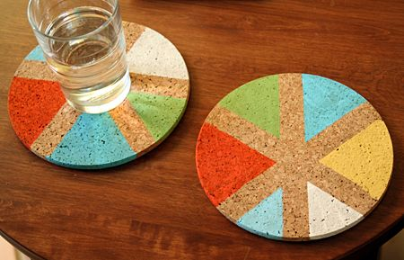 Embellished cork coasters are a personal, practical hostess gift. Create stripes with masking tape & initials with vinyl letters. With a stencil brush, apply craft paint, let it dry, then remove tape or letter. Tie together with ribbon and give with a bottle of booze. ~ Martha Stewart