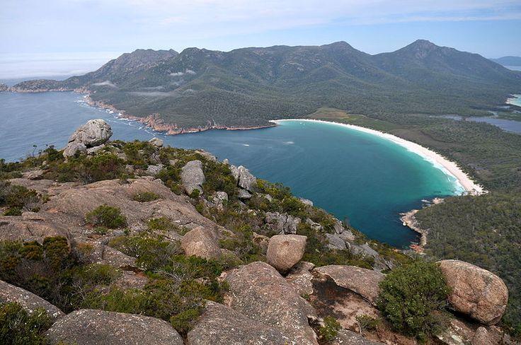 An uninterrupted vista of Wineglass Bay and The Hazards range, taken from the peak of Mt Amos, on the Freycinet Peninsula, Tasmania, Australia.