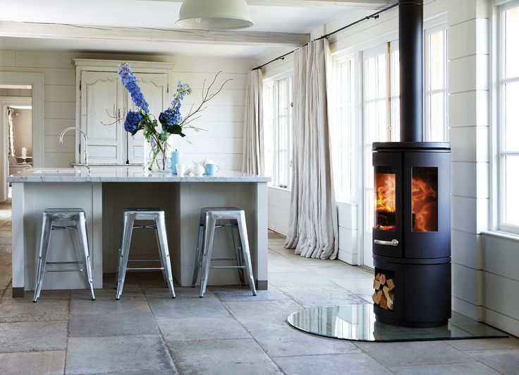 MORSO 7900 with the 180 degree view of the fire!!!!!  If we do not put one in our existing fire mantle ...then I want one of these in our diningroom!!!  I LOVE THIS ONE TOO!!!  <3 :)   scandinavian-morso-stove
