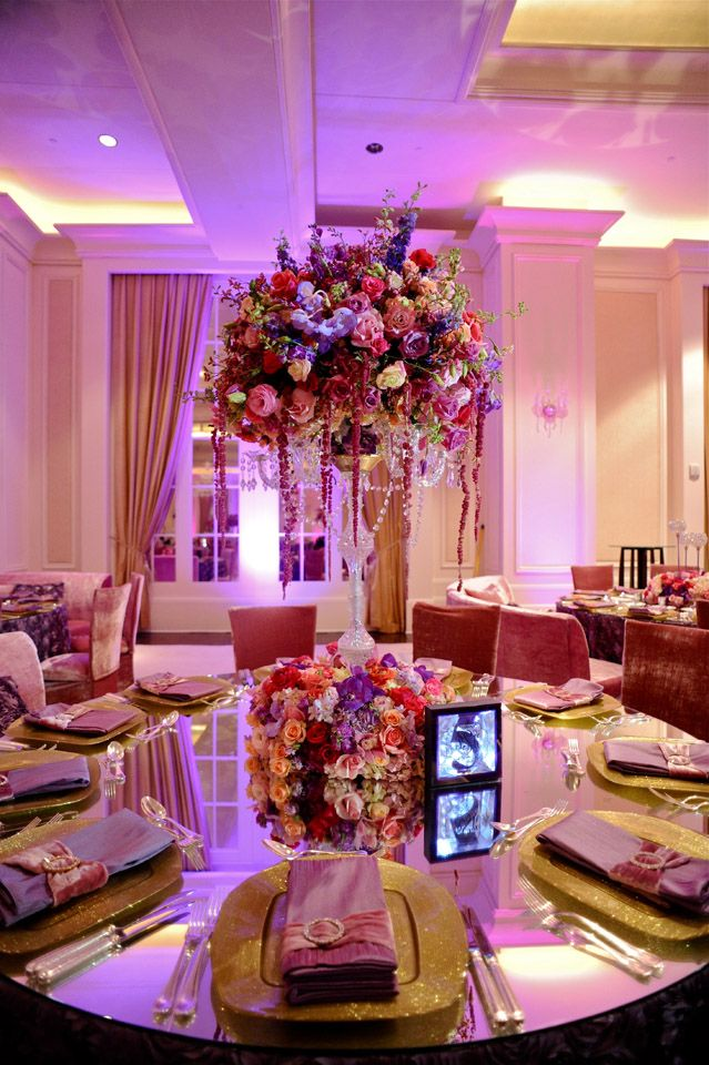 Lush Flowers, Sparkly Gold Chargers, Beautiful Napkin Treatments