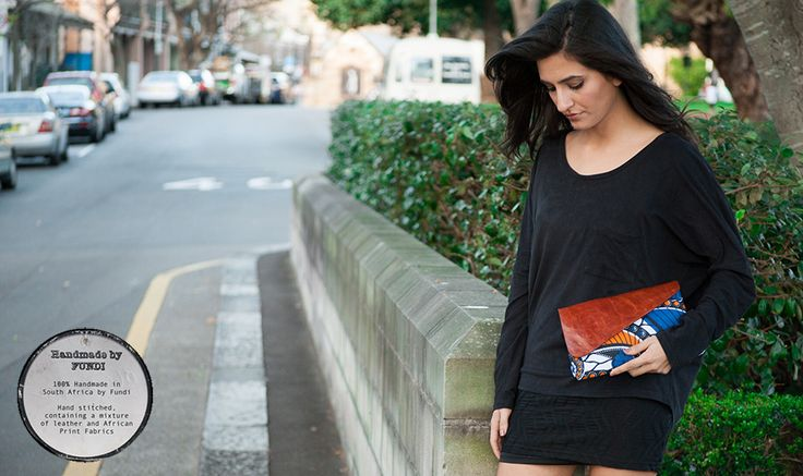 A gorgeous small clutch created with vibrant African fabrics and leather. Hand stitched by Handmade by FUNDI and brought to you by Modern Tradition - Where tradition meets today!  http://www.moderntradition.com.au/small-clutches/