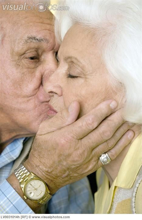 An elderly couple kissing, they have seen so much, be compassionate!